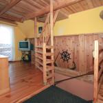 Pokój dzienny na piętrze z wyjściem na taras